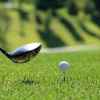 golf ball on tee and golf club