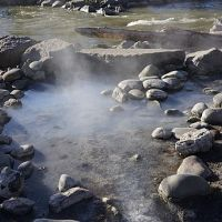 rocks piled to create a pool around a hot springs