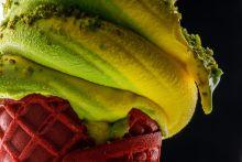 closeup photo of mango soft serve ice cream cone